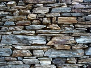 Natural multicolored stone retaining wall